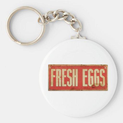 Huevos frescos llavero redondo tipo pin