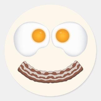 Huevos y pegatina de la mueca del tocino