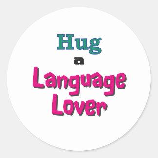 Hug a language lover classic round sticker