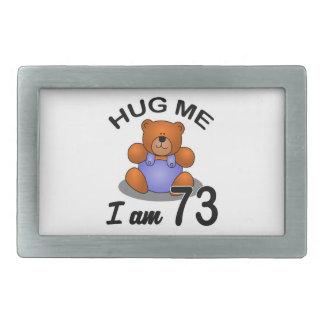 Hug me I'm 73 Rectangular Belt Buckle