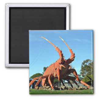 Huge crab Statue in grassy ground Magnets