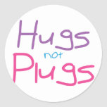 Hugs not Plugs (Pink) Round Stickers