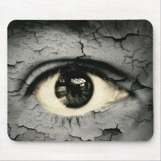 Human eye serrounded by Peeling skin Mouse Pad