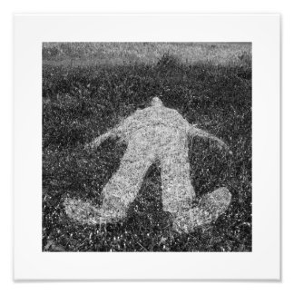 human figure outline imprinted on grass photographic print