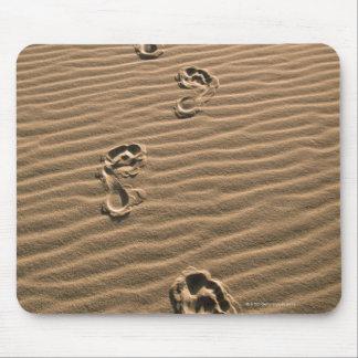 Human footprints on sandy beach mouse pad