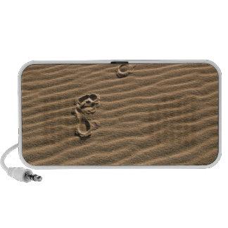 Human footprints on sandy beach portable speakers