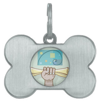 Human hand holds a paper roll secret article pet tag