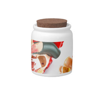 Human heart model isolated on white background candy jar