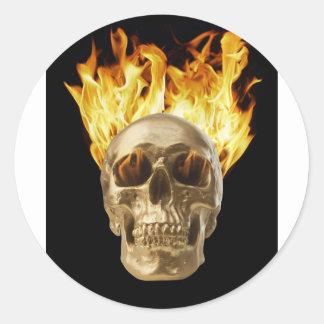 human skull hair and eye sockets on fire sticker