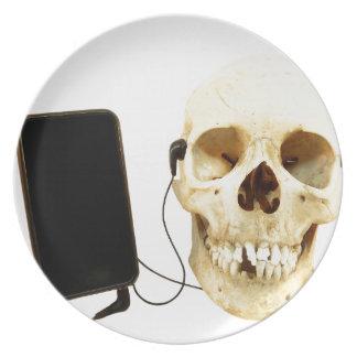 Human skull listening music with earphone plate