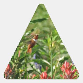Hummingbird in wild flowers triangle sticker