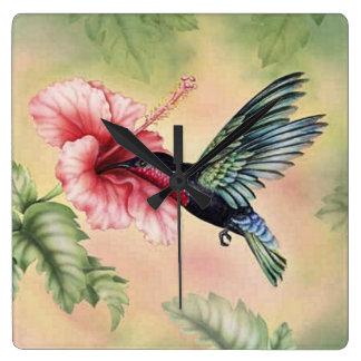 hummingbird on tropical flower square wall clock