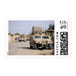 Humvee s conduct security during a patrol stamp