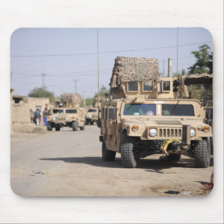 Humvee's conduct security during a patrol mouse pad