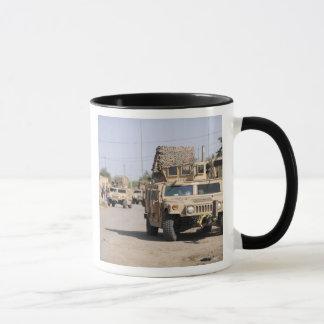Humvee's conduct security during a patrol mug