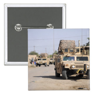 Humvee's conduct security during a patrol pinback button