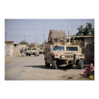Humvee's conduct security during a patrol poster