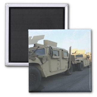 Humvees sit on the pier at Morehead City Magnet
