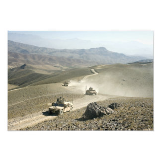 Humvees traverse rugged mountain roads photo print