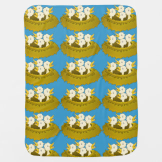 Hungry chicks in a nest swaddle blankets
