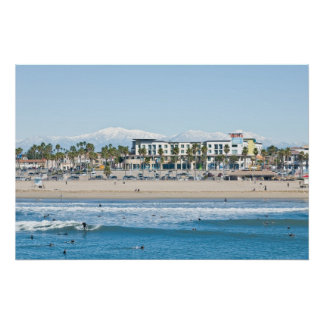Huntington Beach and Snow Capped Mountains Poster