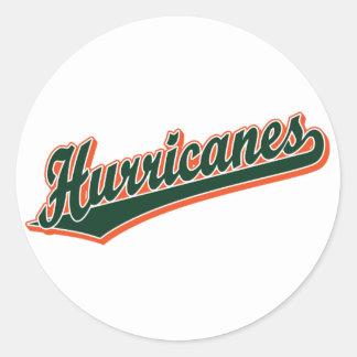 Huracanes en verde y naranja etiquetas redondas