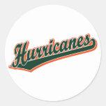 Huracanes en verde y naranja pegatinas redondas