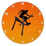 Hurdler amarillo-naranja reloj de pared