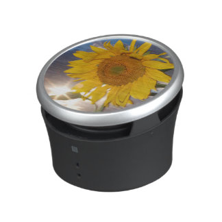 Hybrid sunflower blowing in the wind at dusk bluetooth speaker