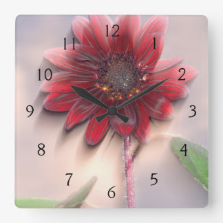 Hybrid sunflower blowing in the wind square wallclocks