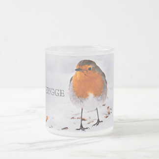 Hygge with a cute robin bird in snow frosted glass coffee mug
