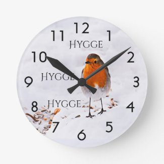 Hygge with a cute Robin bird in snow