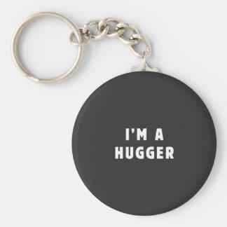 I am a hugger basic round button keychain