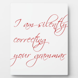 I am silently correcting your grammar-script plaque