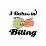 i believe in biting postcard