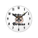 i believe in braces round wall clocks