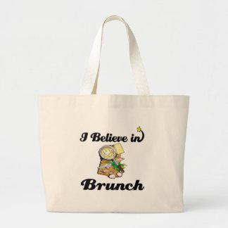 i believe in brunch tote bags