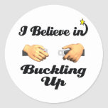 i believe in buckling up round stickers
