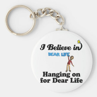 i believe in hanging on for dear life basic round button keychain