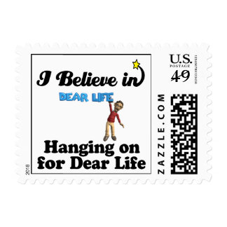 i believe in hanging on for dear life postage stamp
