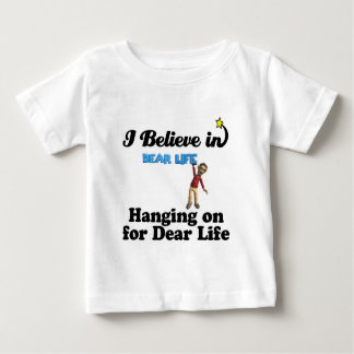 i believe in hanging on for dear life shirts