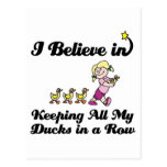 i believe in keeping all ducks in a row postcard