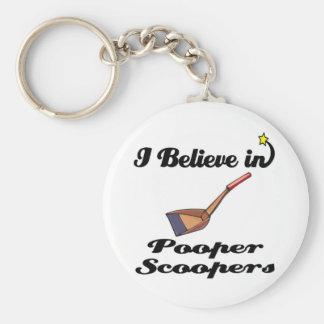 i believe in pooper scoopers keychain