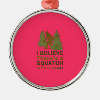 I believe there's a SQUATCH in these woods pink Round Metal Christmas Ornament