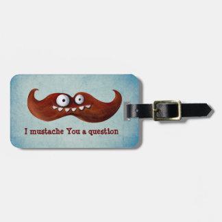 I bigote usted una pregunta… etiquetas de maletas
