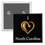 I botón en negro, oro de Carolina del Norte del co Pin