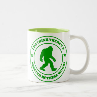 I DO THINK THERE'S A SQUATCH IN THESE WOODS green Mugs