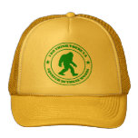 I DO THINK THERE'S A SQUATCH IN THESE WOODS green Trucker Hat