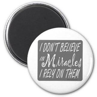I DON'T BELIEVE IN MIRACLES I RELY ON THEM T-SHIRT 2 INCH ROUND MAGNET