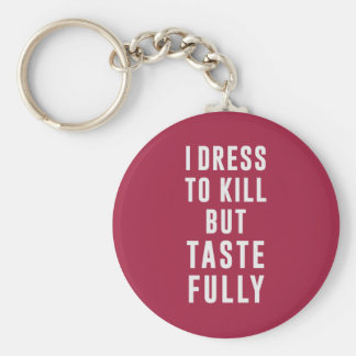 I dress to kill, but tastefully basic round button keychain